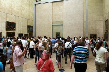Paris, France, July 2009 - Louvre Museum Looking at Mona Lisa