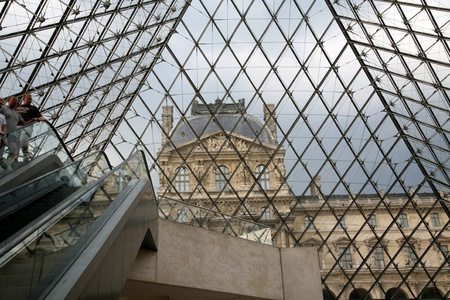 Paris, France, July 2009 - Louvre Museum Looking up through the Glass Pyramid