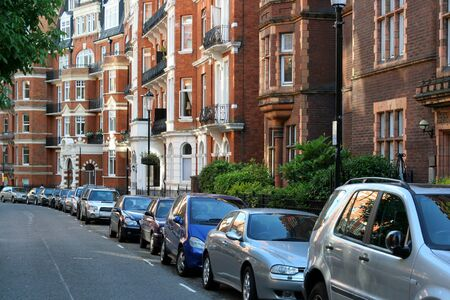 London, England, July  2009 - residential street with elegant apartment buildings in Kensington district