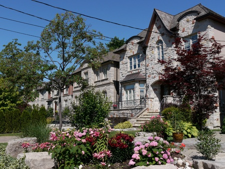 Chicago, USA, July 2011 - suburban street with modern houses and flower garden Stock Photo - 9889457