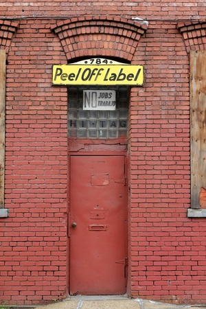 Brooklyn, New York, May 2011 - sign of the recession, closed door of business with no jobs
