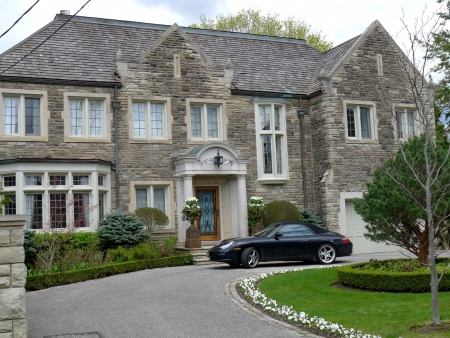 old english: Lake Forest, Illinois, USA, August, 2011, old English style stone house with circular driveway