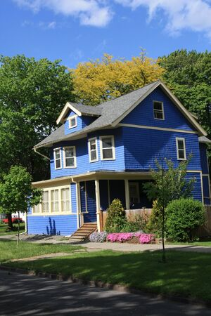 Ithaca, NY, USA, May 2009 - Colorfully decorated house with blue siding