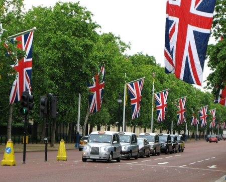 jacks: London, England, June 2007 - The Mall draped with Union Jacks, and line of taxis Editorial