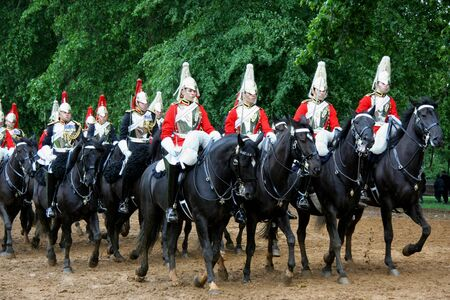 cavalry: London, England - May  2007: Members of the Household Cavalry, the royal horse guards who parade in front of Buckingham Palace, practice their routine on the riding course in Hyde Park.
