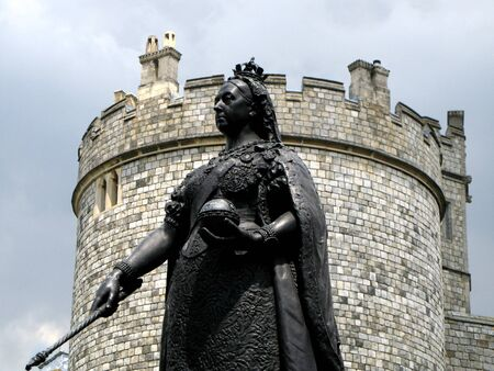 sceptre: Windsor, England, June 2007 - Exterior castle wall of Windsor Castle and statue of Queen Victoria