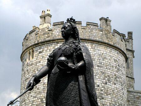 sceptre: Windsor, England, June 2007 - Exterior castle wall of Windsor Castle and statue of Queen Victoria