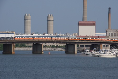 electric generating plant: Boston, USA, July 2008 - Bridge over harbour with subway train and electric generating plant Editorial