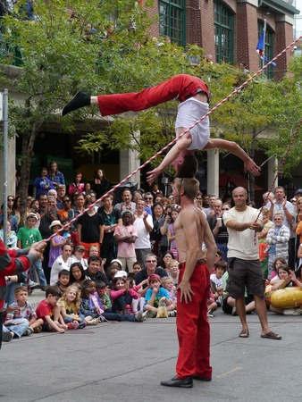 Toronto, Canada, August 2011 - Acrobats performing at Buskerfest street fair Editorial