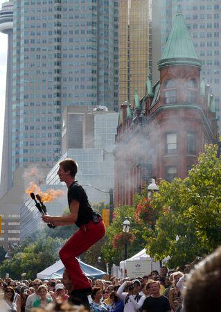 busker: Toronto, Canada, August 2011 - Acrobats performing at Buskerfest street fair Editorial
