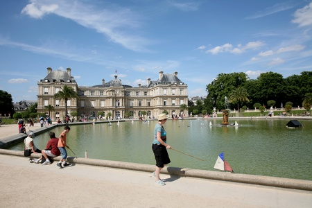 children pond: Paris, France, July 2009 - playing with model boats on the pond in front - playing with model boats on the pond in front of Luxembourg Palace in Jardin du Luxembourg Editorial