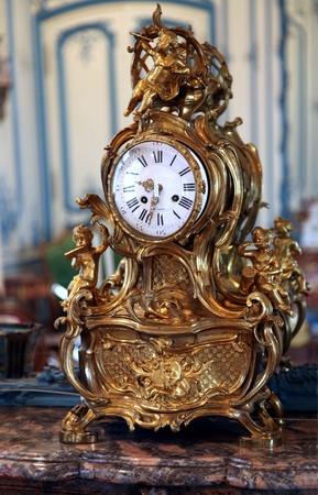 Paris, France, July 2009 - ornate antique clock in the Carnavalet Museum