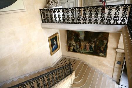 elegant staircase: Paris, France, July 2009 - elegant staircase in historic 16th century Carnavalet mansion