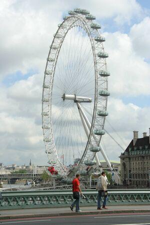 viewed: London, England, July 2009 -  the London Eye ferris wheel viewed from Westminster Bridge