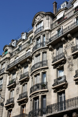 Paris, France,  July, 2009 - apartment building on the Left Bank with ornate wrought iron balcony railings Stock Photo - 10622852