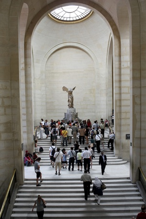 Paris, France, July 2009 - Louvre staircase and Winged Victory of Samothrace Sculpture