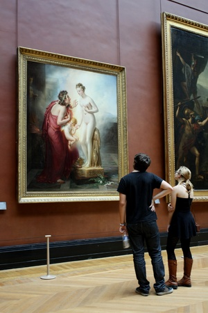 art gallery: Paris, France, July 2009 - Louvre Museum, couple admires a romantic painting