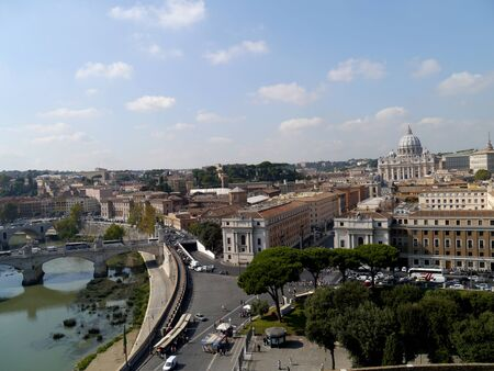 Rome, Italy, October 2011 - Skyline looking over the Tiber River, with Dome of St. Peter Stock Photo - 10950737