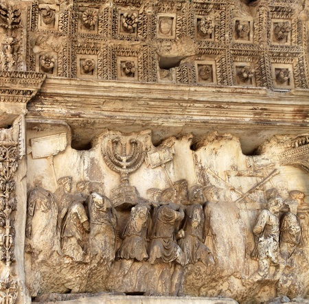 captives: Rome, Italy, October 2011 - Detail from the Arch of Titus, celebrating Roman conquest of Jerusalem and showing Menorah taken from the Jewish Temple Editorial