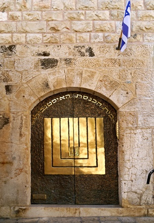 Jerusalem, Israel, October 2011 -  synagogue with artistic brass door in in the Old City