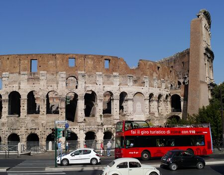 Rome, Italy, October 2011 -  Coliseum with city traffic on street