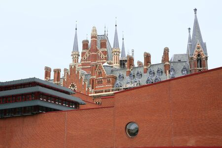 London, England - July  2009:  Modern architecture of British Library and old Gothic style of St. Pancras train station Stock Photo - 11103610