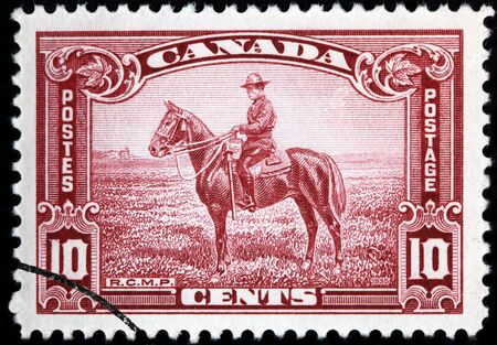 mountie: Canada, 1935, postage stamp depicting Royal Canadian Mounted Police Editorial