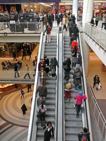 Chicago, USA, September 2010 - shoppers on escalator in multi-level shopping mall