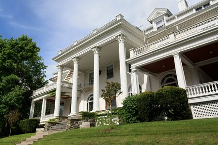 Ithaca, NY, USA, old mansion with columns and large porch