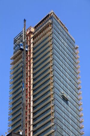 high rise: apartment building under construction Editorial