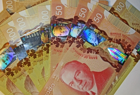 Toronto, Canada, June 2012 - new high tech Canadian polymer banknotes with holograms Stock Photo - 13887571