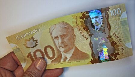 Toronto, Canada, June 2012 - new high tech Canadian polymer banknote with holograms