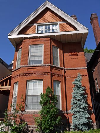 old brick house with large gable, Toronto, 2011