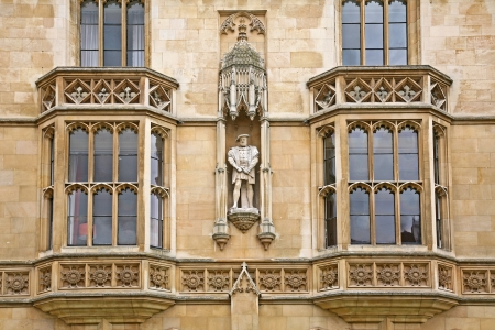 viii: Street facade of Kings College,  Cambridge University, with statue of King Henry VIII