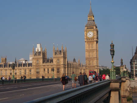 London, 2013, commuters walk across Westminster Bridge
