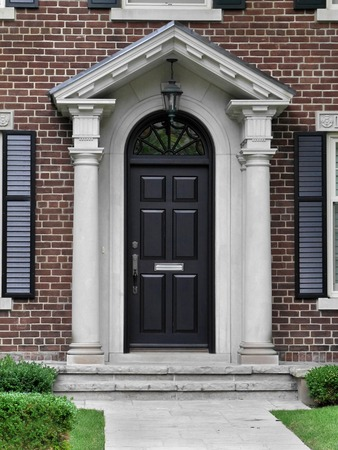 gable: black front door with gable style portico