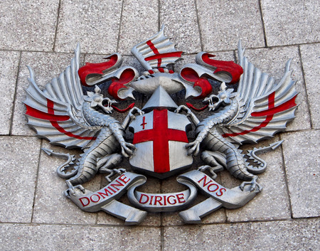 city coat of arms: City of London Coat of Arms on the wall of a building 2013 Stock Photo