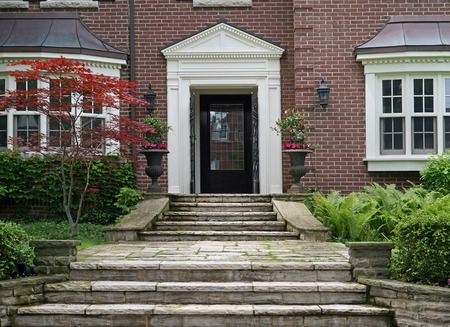 from the front: house front door with flagstone steps
