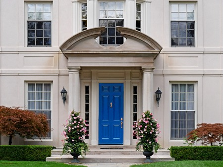upper class: Front door of house with portico and columns