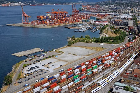 seaport: Busy seaport with container trains, Vancouver 2015