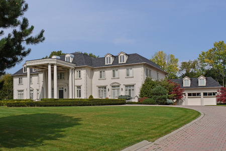 suburban: large suburban house with circular driveway