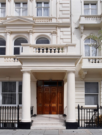 stucco facade: Portico entrance to London apartment building in Borough of Kensington Editorial