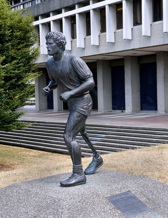 the alumnus: VANCOUVER -JULY 2015:   Statue of Terry Fox, the one-legged hero who ran to raise money for cancer victims, at Simon Fraser University, from which he graduated, as seen in Vancouver in July 2015.