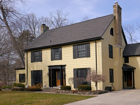 two storey house with large yard and yellow siding,  Connecticut, 2016 Editorial