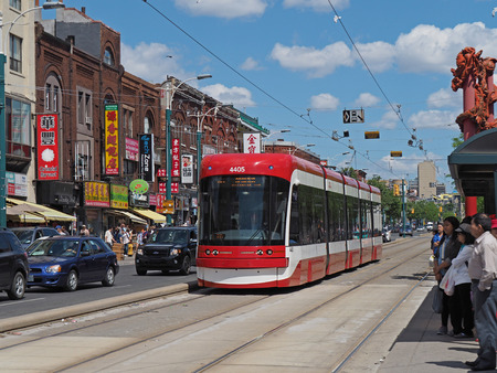streetcar: Toronto Chinatown shopping district with streetcar, 2016 Editorial