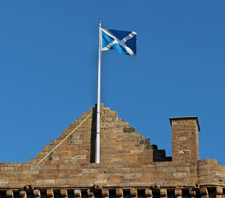 Scottish national flag atop Linlithgow Castle, birthplace of Mary Queen of Scots
