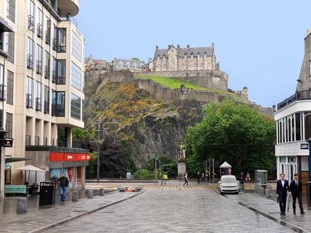crag: EDINBURGH - SEPTEMBER 2016:  The rocky volcanic crag on which the castle is perched is a looming presence in the downtown above Princes Street as seen circa 2016.