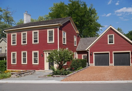 house with red siding and attached garage