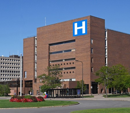building exteriors: large modern building with H sign for hospital