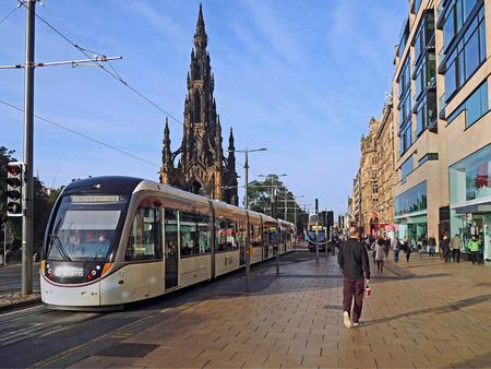 princes street: EDINBURGH - SEPTEMBER 2016:  Sir Walter Scotts monument and Princes Street, the main shopping and transportation hub, as seen in Edinburgh circa 2016.